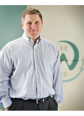 Dr. Ryan Wiesemann standing with his hands in his pockets.